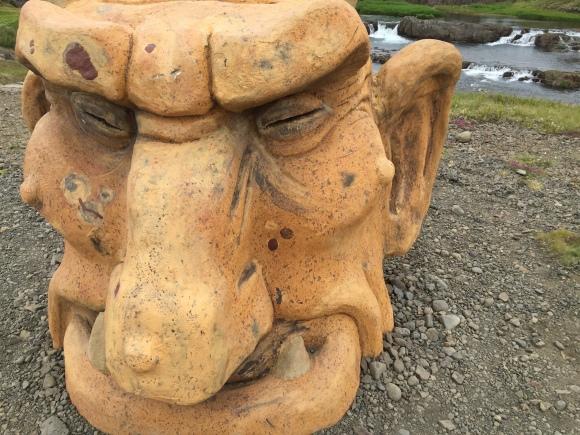Iceland troll head by falls