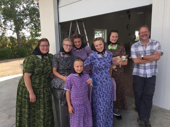 Hutterite women offering iced tea