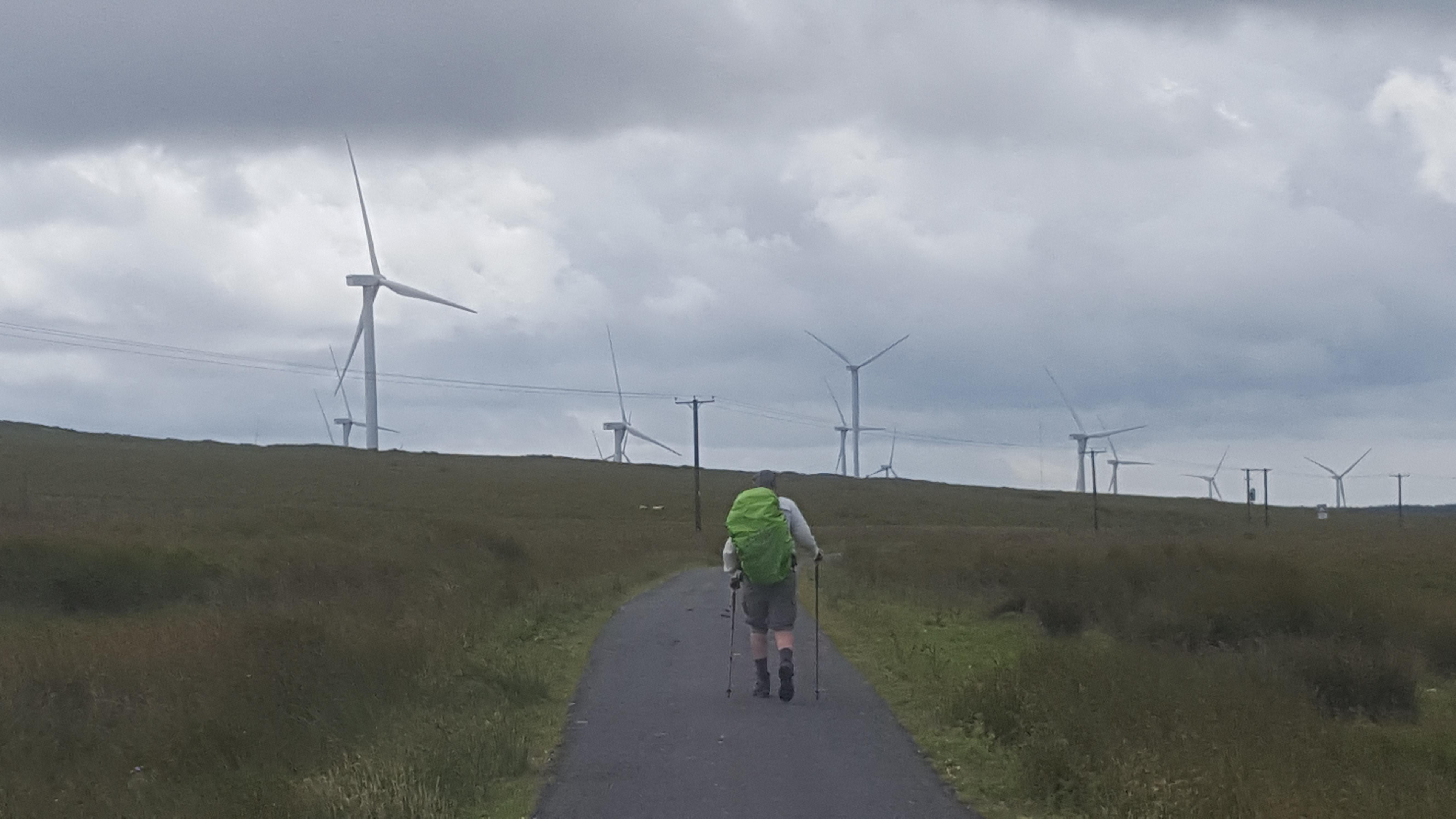 Ken walking toward windfarm